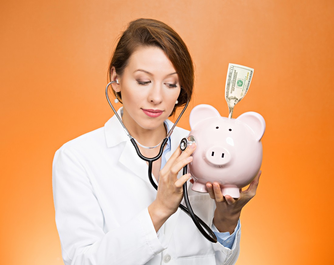 stethoscope doctor and piggy bank